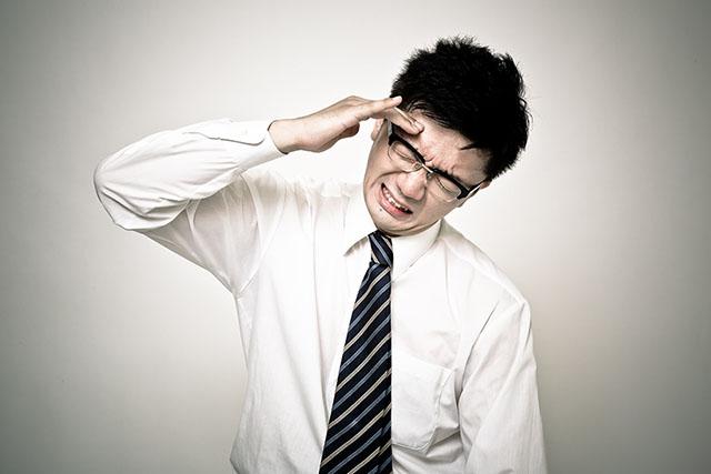ストレスをかかえる人イメージ